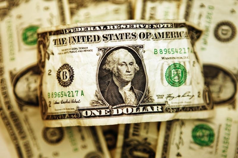 Dollar Down, but Near One-Year High