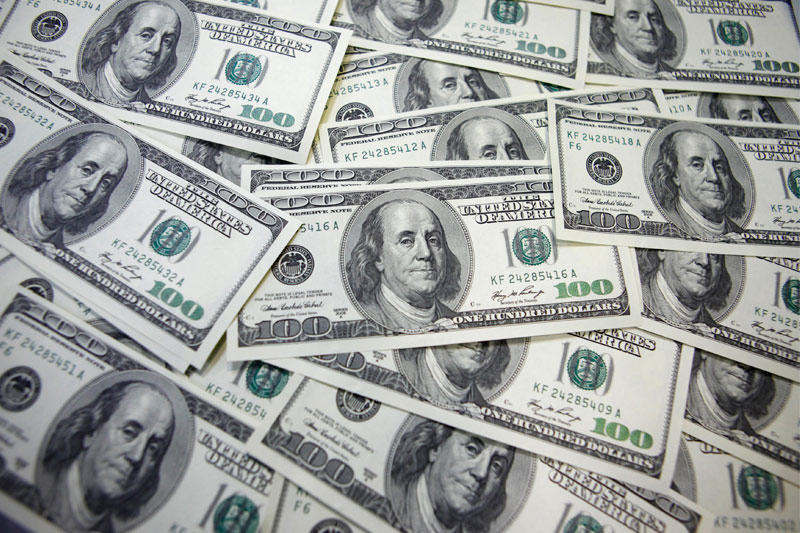 Dollar Edges Higher Overall