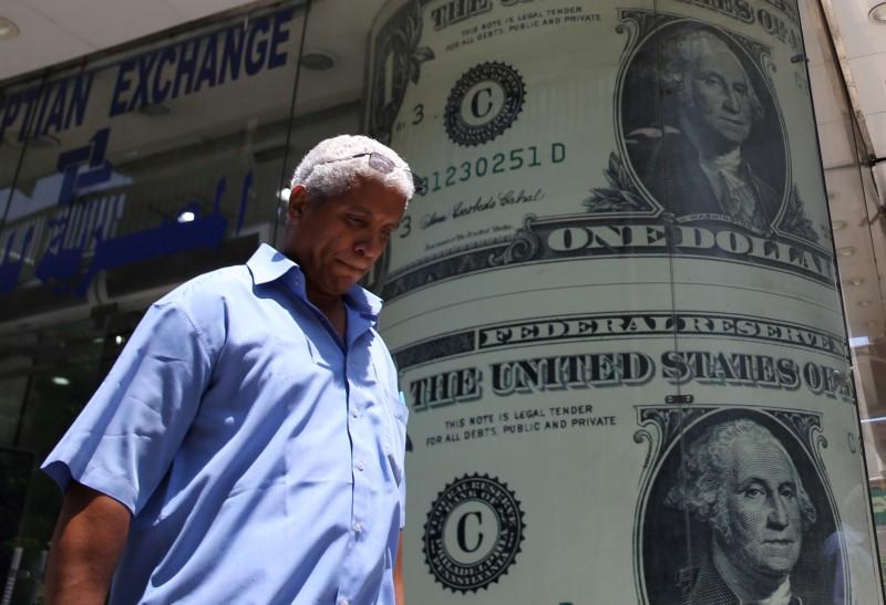 Dollar Edges Higher on Hawkish Fed