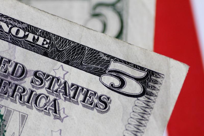 Dollar Edges Lower amid Fed Meeting