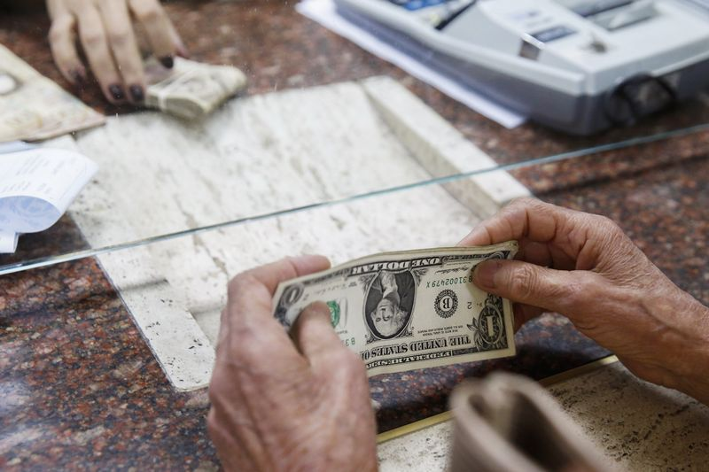 Dollar Edges Lower