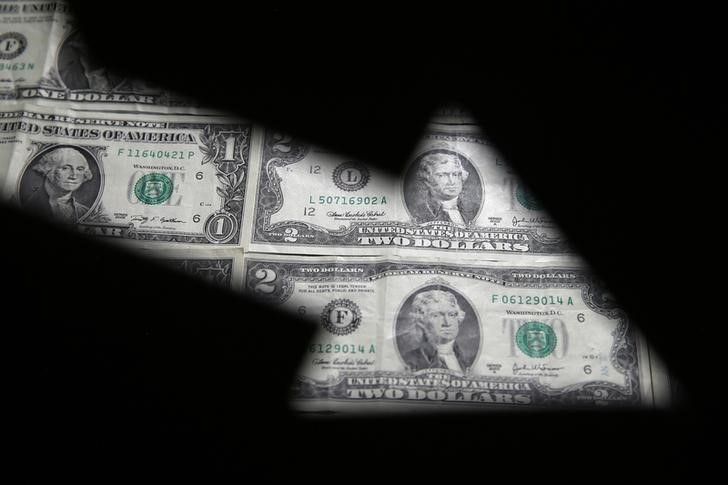 Dollar Edges Off One-Month High