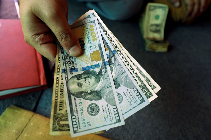 Dollar Up but Remains Near Week Low