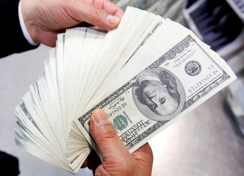Dollar choppy after Fed statement