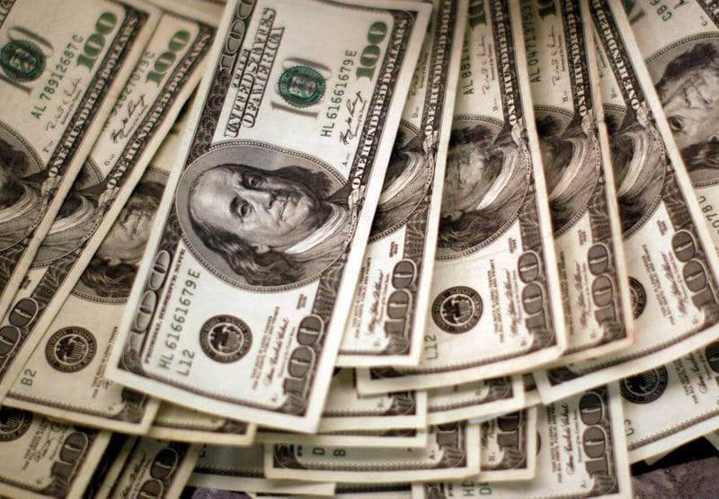 Dollar firm as virus' spread and stimulus stalemate raise caution
