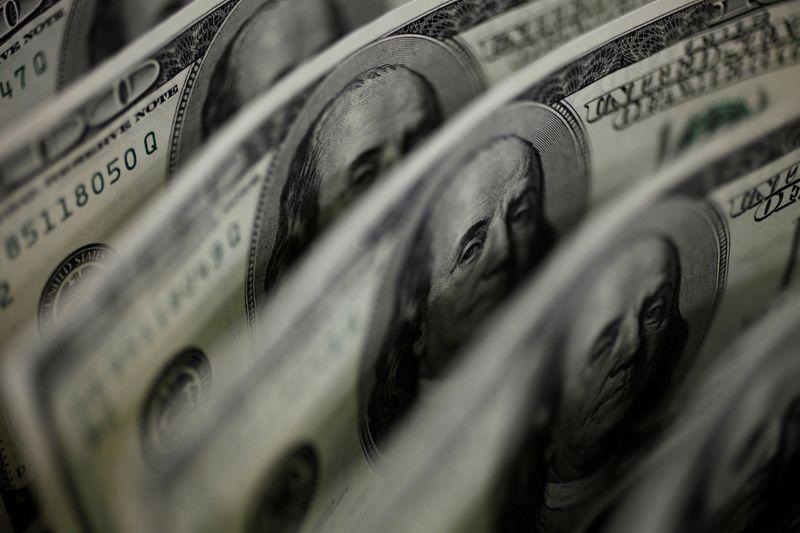 Dollar gains further as Treasury yields