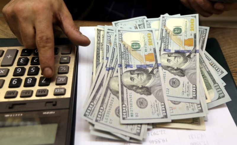Dollar off four-month high as inflation jitters ease