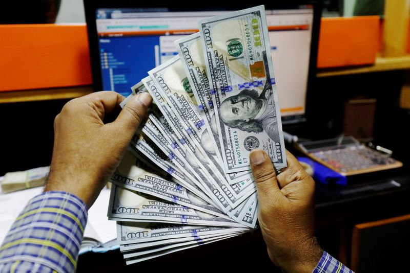 Dollar rises but still set for biggest weekly loss since May