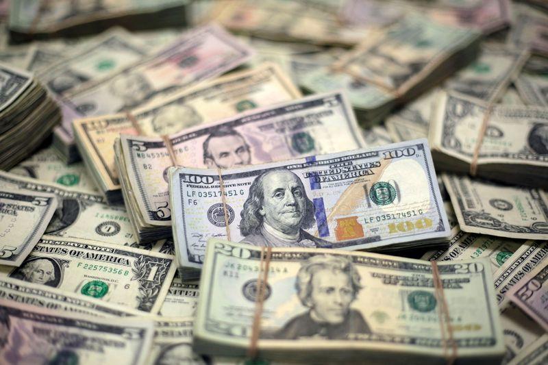 Dollar wallows near one-week low
